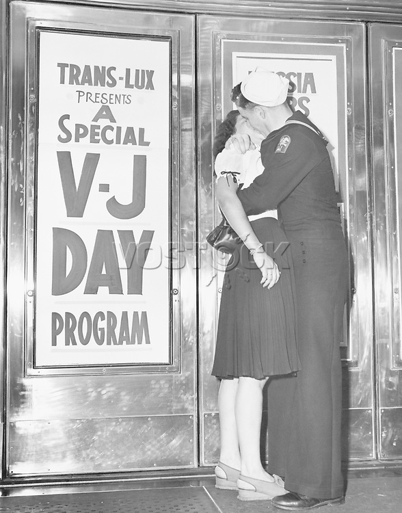 U.S. sailor and his girlfriend celebrate news of the end of war with Japan in front of the Trans-Lux Theatre in New York's Time Square, August 14, 1945