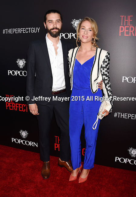 BEVERLY HILLS, CA - SEPTEMBER 02: Composer David Fleming (L) and guest arrive at the premiere of Screen Gems' 'The Perfect Guy' at The WGA Theater on September 2, 2015 in Beverly Hills, California.