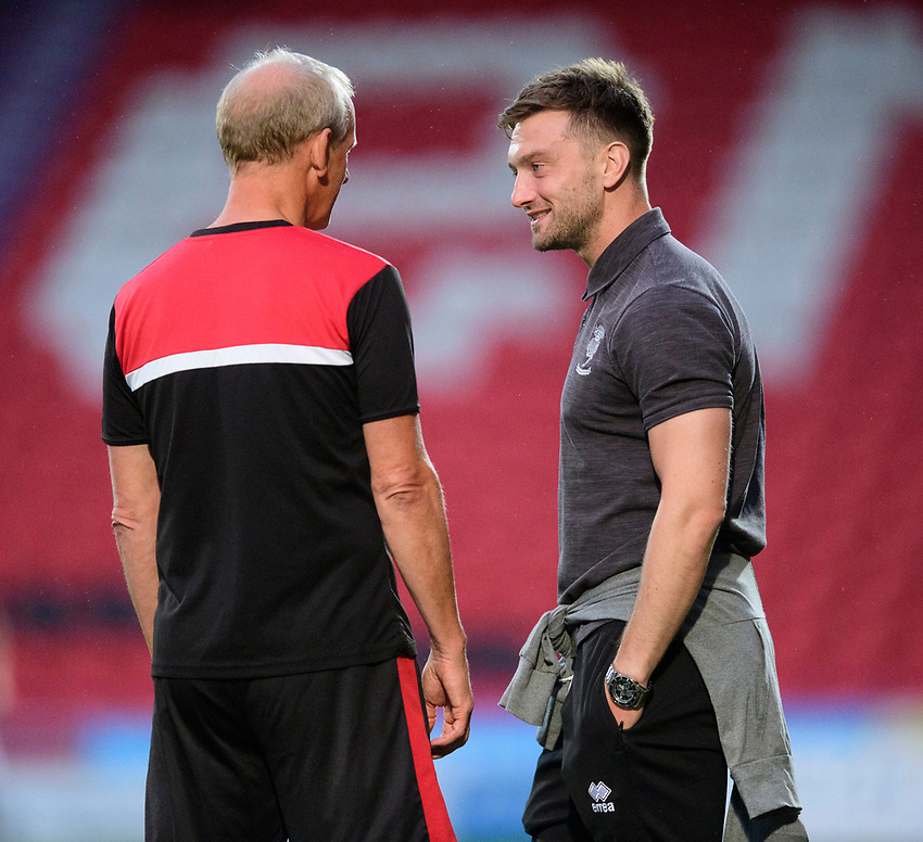 Lincoln City's Lee Frecklington, right, talks to Doncaster Rovers development manager John Schofield<br /> <br /> Photographer Chris Vaughan/CameraSport<br /> <br /> EFL Leasing.com Trophy - Northern Section - Group H - Doncaster Rovers v Lincoln City - Tuesday 3rd September 2019 - Keepmoat Stadium - Doncaster<br />  <br /> World Copyright © 2018 CameraSport. All rights reserved. 43 Linden Ave. Countesthorpe. Leicester. England. LE8 5PG - Tel: +44 (0) 116 277 4147 - admin@camerasport.com - www.camerasport.com