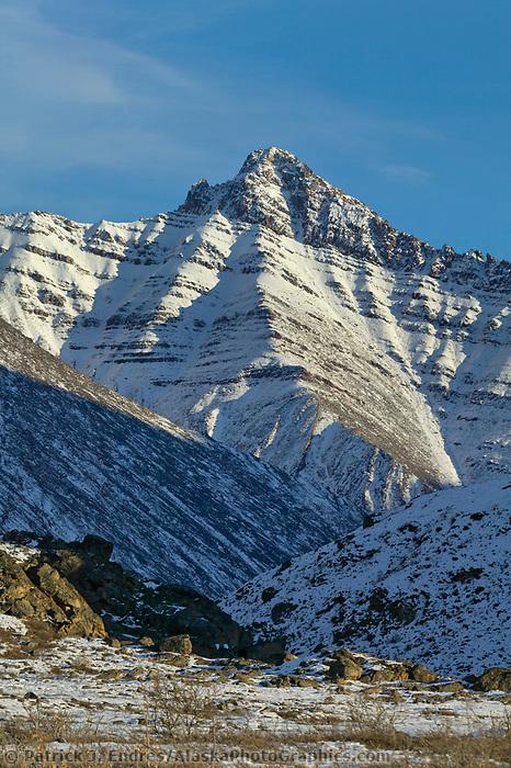 Fresh snow on the Brooks Range mountains reveals fold patterns in the rock, Atigun Canyon, Alaska