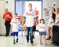 Phillies outfielder Cody Asche (center) arrives with Barclay Elementary School students Liam (left) and Katie Petersen (right) for a special assembly Wednesday June 17, 2015 in Warrington, Pennsylvania. Liam and Kate Petersen's parents won the unique experience through the Phillies Charities, Inc. Phantastic Auction. (Photo by William Thomas Cain)