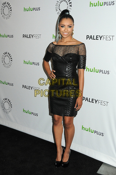 "Kat Graham.PaleyFest 2012 Presents ""The Vampire Diaries"" held at the Saban Theatre. Beverly Hills, California, USA, .10th March 2012.full length off the shoulder sheer leather dress  black  corset bustier hand on hip .CAP/ADM/BP.©Byron Purvis/AdMedia/Capital Pictures."