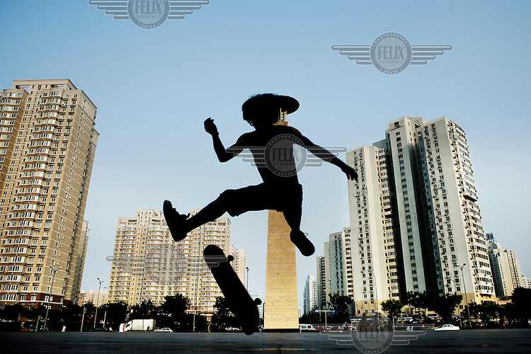 A young person skateboards in Wangjing, a large residential district in the city, which is also becoming an important business centre.