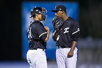 Kannapolis Intimidators catcher Seby Zavala (21) has a chat on the mound with relief pitcher Jaider Rocha (40) during the game against the Hickory Crawdads at Kannapolis Intimidators Stadium on April 8, 2016 in Kannapolis, North Carolina.  The Crawdads defeated the Intimidators 8-2.  (Brian Westerholt/Four Seam Images)