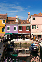The colors of the houses on the colorful lagoon island Burano just north of Venice, follow a specific system. The legend tells that the practice began so fishermen on the island could locate their home in the darkness. Today, if a homeowner wants to paint their house they must receive permission from the local government who will then give a limited selection of color options selected for that location.
