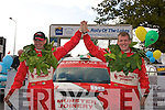1833-1834.----------.Top of the Podium.-----------------.Alan Ring(Lt)from Castleisland and his navigator Adrian Deasy celebrate their victory in the GpN category of the International Rally of the Lakes,at the finish ramp outside the GlenEagle Hotel Killarney last weekend.