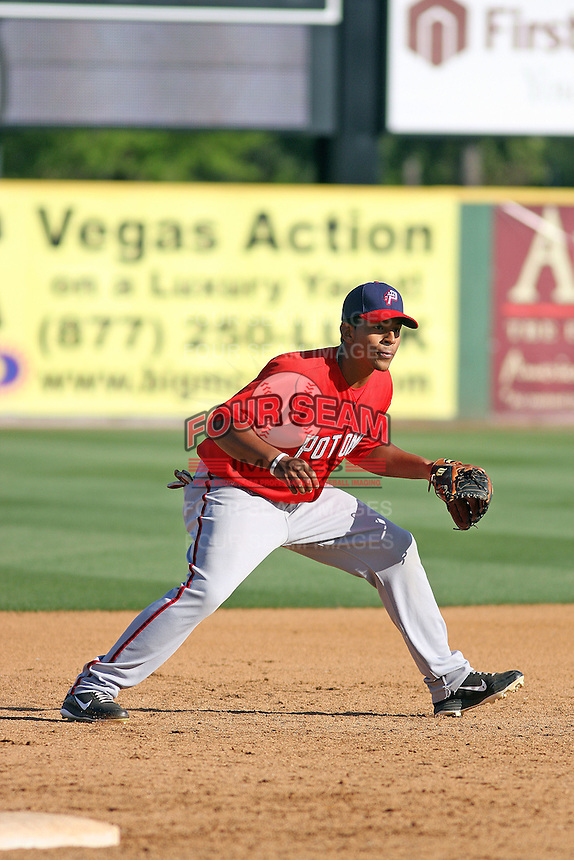 Potomac Nationals infielder Adrian Sanchez #9 taking infield before a game against the Myrtle Beach Pelicans at Tickerreturn.com Field at Pelicans Ballpark on April 11, 2012 in Myrtle Beach, South Carolina. Potomac defeated Myrtle Beach by the score of 6-3. (Robert Gurganus/Four Seam Images)