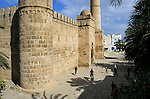 Young people playing football in front of the ribat, Sousse, Tunisia.