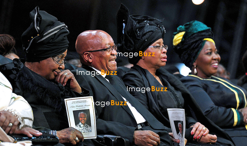 Qunu, South Africa: 15.12.2013: STATE FUNERAL FOR NELSON MANDELA<br /> WINNIE MANDELA, PRESIDENT ZUMA, AND GRACA MACHEL<br /> at the funeral service for former President Nelson Mandela in Qunu, Eastern Cape, South Africa