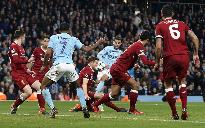 Manchester City's Bernardo Silva has his close-range shot charged down by Liverpool's James Milner<br /> <br /> Photographer Rich Linley/CameraSport<br /> <br /> UEFA Champions League Quarter-Final Second Leg - Manchester City v Liverpool - Tuesday 10th April 2018 - The Etihad - Manchester<br />  <br /> World Copyright &copy; 2017 CameraSport. All rights reserved. 43 Linden Ave. Countesthorpe. Leicester. England. LE8 5PG - Tel: +44 (0) 116 277 4147 - admin@camerasport.com - www.camerasport.com