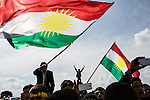 The Kurdistan flag flies over young men listening to political speeches at Newroz, the Kurdish New Year celebration, in Viranşehir, Turkey, March 18, 2015. Newroz, or Nowruz, is an ancient holiday celebrated by a multitude of ethnic groups across Iran, Central Asia, and the Caucuses, and ushers in the first day of Spring, March 21. For Kurds, Newroz is a means of political and cultural expression, featuring Kurdish politicians, activists, and musicians, and has become a manifestation of Kurdish identity. In Turkey, the celebrations begin a few days before the Vernal Equinox, culminating in a huge gathering in the heart of Turkey's Kurdish population, the southeastern city of Diyarbakir. This year, PKK founder Abdullah Öcalan, who despite serving a life sentence for treason still enjoys widespread influence among Kurds, sent a letter that was read at Newroz in Diyarbakir, calling for an end to the PKK's armed struggle against the Turkish state.
