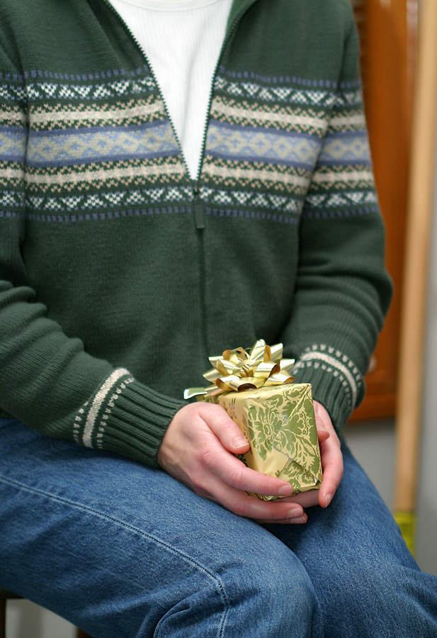 Woman's hands holding wrapped Christmas gift