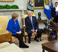 United States President Donald J. Trump meets with Chancellor Angela Merkel of Germany, in the Oval Office of the White House in Washington, DC, April 27, 2018.<br /> Credit: Chris Kleponis / Pool via CNP /MediaPunch