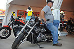 A man leans on a motorcycle display at the Minnesota State Fair in Saint Paul, Minnesota on August 30, 2008.
