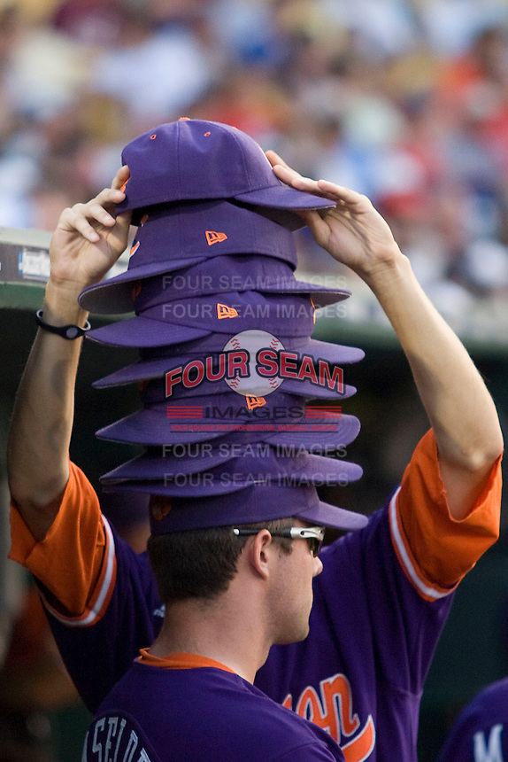 Clemson stacked hat ritual in Game 14 of the NCAA Division One Men's College World Series on June 26th, 2010 at Johnny Rosenblatt Stadium in Omaha, Nebraska.  (Photo by Andrew Woolley / Four Seam Images)
