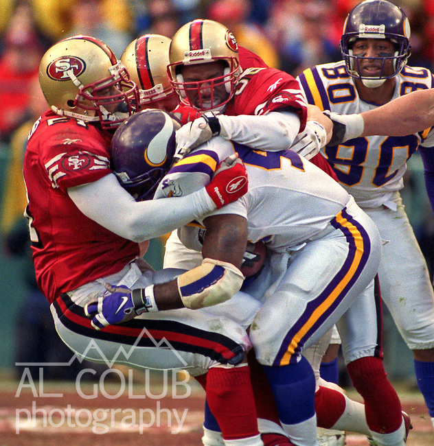 San Francisco 49ers vs. Minnesota Vikings at Candlestick Park Saturday, January 3, 1998.  49ers beat Vikings  38-22.  San Francisco 49ers linebacker Ken Norton (51) and linebacker Chris Doleman (56) stop Viking running back.