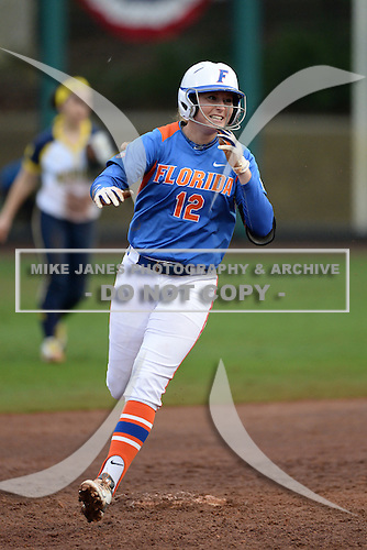 Florida Gators Taylore Fuller (12) runs the bases after hitting a home run during a game against the Michigan Wolverines on February 8, 2014 at the USF Softball Stadium in Tampa, Florida.  (Copyright Mike Janes Photography)