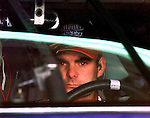 NASCAR Winston Cup Champion Jeff Gordon looks through the windshield of the #24 Dupont Chevrolet Monte Carlo as he leaves the garage area at DIS prior to a practice run, Wednesday, Feb. 10, 1999.(Brian Myrick)
