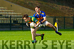 Ruairi Doyle St Brendan's College gets to the ball ahead of Daire Keane Tralee CBS during the Corn Uí Mhuirí quarter final in Killarney on Wednesday