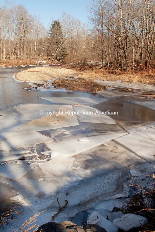 SOUTHBURY, CT-07 January 2014-010714BF04- Sheets of ice form on the Pomperaug River along Roxbury Road in Southbury Tuesday. Temperatures remained in the teens and are expected to warm during the week.    Bob Falcetti Republican-American