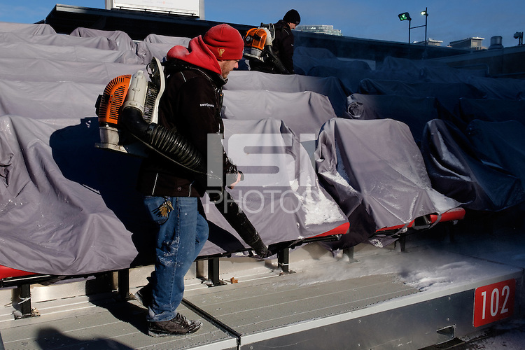 Toronto, ON, Canada - Friday Dec. 09, 2016: Workers clear snow  during training prior to MLS Cup at BMO Field.