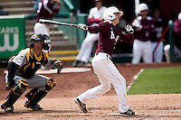 Travis McComack #31 of the Missouri State Bears follows through his swing after making contact on a pitch during a game against the Wichita State Shockers at Hammons Field on May 5, 2013 in Springfield, Missouri. (David Welker/Four Seam Images)
