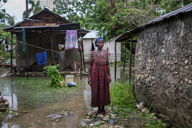 Lumis Sayafey, 60, stands in front of her home, in the coastal commune of Leogane, which was flooded by the heavy rain that accompanied Hurriance Matthew.<br /> <br /> Hurricane Matthew, the first category 5 Atlantic hurricane since 2007, hit the island on 4 October 2016. Winds of up to 230km/h (145mph) tore across the worst affected areas, mainly in the south of the island, killing around over 1,000 people and leaving hundreds of thousands in need of assistance.