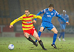 St Johnstone v Partick Thistle....09.02.11  Scottish Cup 5th Round.David Rowson closed down by Murray Davidson.Picture by Graeme Hart..Copyright Perthshire Picture Agency.Tel: 01738 623350  Mobile: 07990 594431