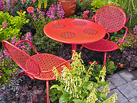 Table and chairs in flower garden display. Al's Nursery. Sherwood, Oregon