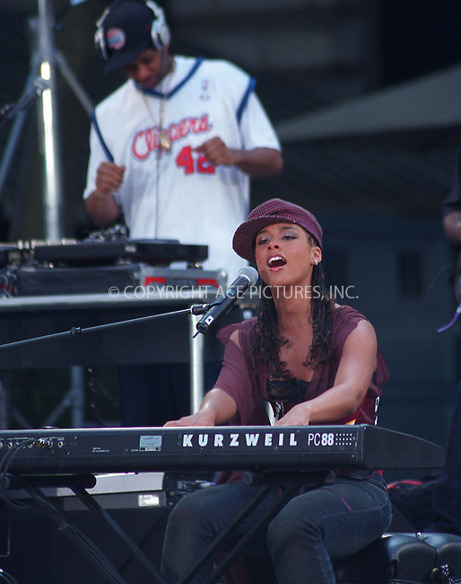 Popular R&B artist ALICIA KEYS, who scored SIX Grammy Awards this year, giving a free concert in Bryant Park in New York. May 31, 2002. Please byline: Alecsey Boldeskul/NY Photo Press.   ..*PAY-PER-USE*      ....NY Photo Press:  ..phone (646) 267-6913;   ..e-mail: info@nyphotopress.com