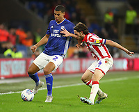 26th November 2019; Cardiff City Stadium, Cardiff, Glamorgan, Wales; English Championship Football, Cardiff City versus Stoke City; Lee Peltier of Cardiff City and Joe Allen of Stoke City challenge for the ball - Strictly Editorial Use Only. No use with unauthorized audio, video, data, fixture lists, club/league logos or 'live' services. Online in-match use limited to 120 images, no video emulation. No use in betting, games or single club/league/player publications