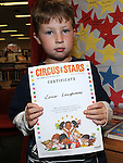 Conor Loughman pictured with his certificate for the Circus Stars summer reading project at the library. Photo: Colin Bell/pressphotos.ie