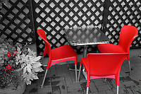 Selective colour red cafe chairs, Vancouver, BC, Canada