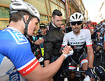 Arnaud Demare (FRA) FDJ wins the 2016 Milan-San Remo race congratulated by Fabian Cancellara (SUI) Trek-Segafredo, running 293km from Milan anf finishing on the Via Roma, San Remo, Italy. 19th March 2016.<br /> Picture: ANSA/Luca Zennaro | Newsfile<br /> <br /> <br /> All photos usage must carry mandatory copyright credit (© Newsfile | Luca Zennaro)