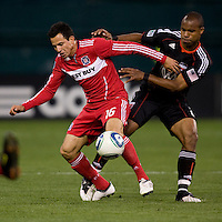 Marco Pappa (16) of the Chicago Fire holds off Julius James (2) of DC United at RFK Stadium in Washington, DC.  The Chicago Fire defeated DC United, 2-0.