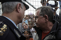 Pictured: Migration Minister Yiannis Mouzalas (R) at the gate of the camp Monday 06 February 2017<br /> Re: Scuffles between migrants and police broke out during a visit by Immigration Policy Minister Yiannis Mouzalas at the Elliniko migrant camp located in the former airport in the outskirts of Athens, Greece.