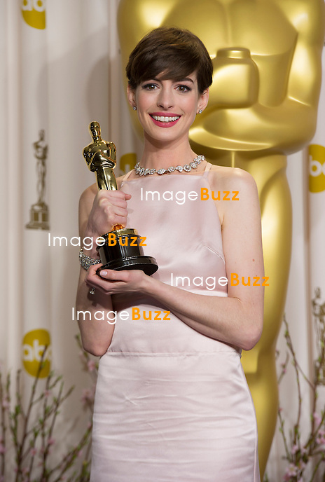Anne Hathaway with the Oscar for Best Supporting Actress for Les Miserables at the 85th Academy Awards at the Dolby Theatre, Los Angeles.