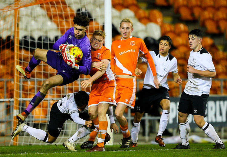 Blackpool's Owen Watkinson challenges Derby County's Bradley Foster-Theniger<br /> <br /> Photographer Alex Dodd/CameraSport<br /> <br /> The FA Youth Cup Third Round - Blackpool U18 v Derby County U18 - Tuesday 4th December 2018 - Bloomfield Road - Blackpool<br />  <br /> World Copyright © 2018 CameraSport. All rights reserved. 43 Linden Ave. Countesthorpe. Leicester. England. LE8 5PG - Tel: +44 (0) 116 277 4147 - admin@camerasport.com - www.camerasport.com