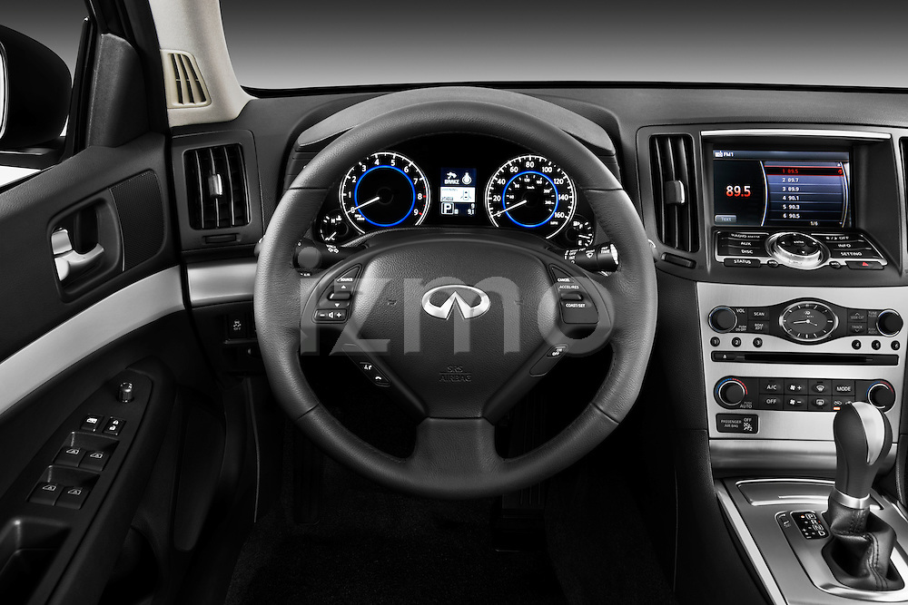 Steering wheel view of a 2011 Infiniti G25 Journey Sedan