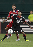 WASHINGTON, DC. - AUGUST 22, 2012:  Lionard Pajoy (26) of DC United keeps the ball from  Daniel Paladini (11) of the Chicago Fire during an MLS match at RFK Stadium, in Washington DC,  on August 22. United won 4-2.