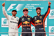 1st October 2017, Sepang, Malaysia;  FIA Formula One World Championship, Grand Prix of Malaysia; Red Bull driver Max Verstappen (C) of the Netherlands, Mercedes driver Lewis Hamilton (L) of Britain and Red Bull driver Daniel Ricciardo of Australia pose for pictures on the podium after the Formula One Malaysia Grand Prix at the Sepang Circuit in Malaysia, on Oct. 1, 2017. Max Verstappen claimed the title of the event