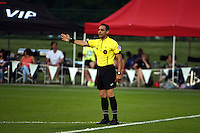 Kansas City, MO - Saturday May 07, 2016: The referee signals a call in the first half between FC Kansas City and Houston Dash during a regular season National Women's Soccer League (NWSL) match at Swope Soccer Village. Houston won 2-1.