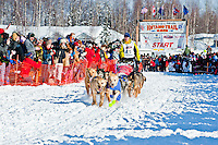 Musher Pat Moon and dogteam leave the gate at Restart of Iditarod 2012, Willow, Alaska, March 4, 2012