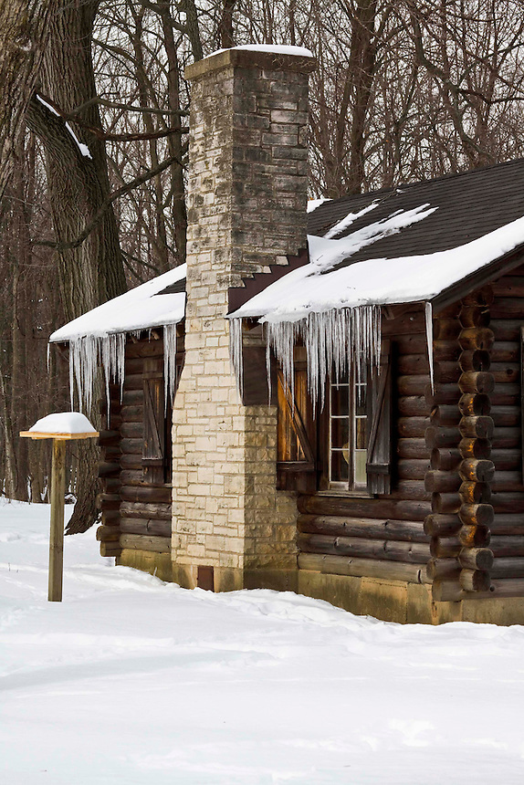Settler cabins in the woods in winter.