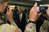 United States Secretary of Defense Donald H. Rumsfeld poses for pictures with soldiers, Marines and airman inside the dining facility of the Abu Ghraib Detention Center in Iraq on May 13, 2004.  Rumsfeld and Chairman of the Joint Chiefs of Staff General  Richard B. Myers are in Iraq to visit the troops in Baghdad and Abu Ghraib.   <br /> Mandatory Credit: Jerry Morrison / DoD via CNP