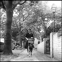 BNPS.co.uk (01202 558833)<br /> Pic: Bonhams/BNPS<br /> <br /> Jackie strolls Georgetown's old streets on her way home with one of Jack's framed canvases and her poodle.<br /> <br /> Fascinating photographs of the Kennedys during their first year of marriage have emerged for auction.<br /> <br /> The intimate snaps of the future US president and his wife Jackie were taken by renowned photographer Orlando Suero who spent five days with the couple at their Georgetown home in May 1954.<br /> <br /> At the time, Kennedy was a young senator from Massachusetts establishing himself as one to watch on the US political scene.<br /> <br /> The collection's owner, Max Lowenherz, donated the bulk of the photographs and negatives to the Peabody Institute of Johns Hopkins University in Maryland, USA.<br /> <br /> He has now decided to put 31 of them up for auction and they are tipped to sell for &pound;4,900 ($6,000).