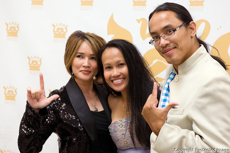 From left to right are Ketsana Vilaylack, Ny Siboura Derry, and Bryan Thao Worra during the Lao Artists Festival in Elgin, IL, photographed on August 21, 2010.  (photo by Khampha Bouaphanh)