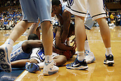 Duke's Nolan Smith fights to maintain control of the ball during the first half against long-time rival UNC. Duke eviscerated UNC 82-50 in the last regular season game at Cameron Indoor Stadium in Durham, N.C., Sat., March 6, 2010.