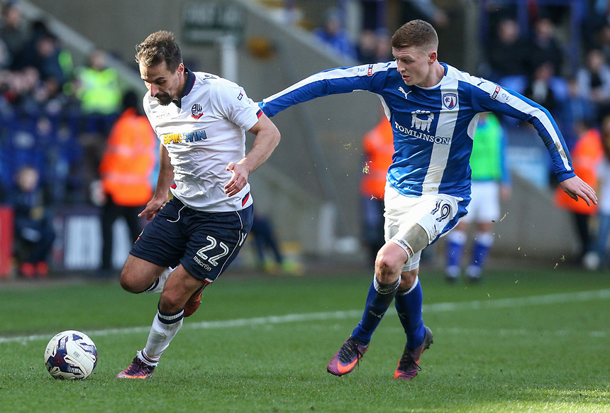 Bolton Wanderers' Filipe Morais holds off the challenge from Chesterfield's Dion Donohue<br /> <br /> Photographer Alex Dodd/CameraSport<br /> <br /> The EFL Sky Bet League One - Bolton Wanderers v Chesterfield - Saturday 1st April 2017 - Macron Stadium - Bolton<br /> <br /> World Copyright &copy; 2017 CameraSport. All rights reserved. 43 Linden Ave. Countesthorpe. Leicester. England. LE8 5PG - Tel: +44 (0) 116 277 4147 - admin@camerasport.com - www.camerasport.com