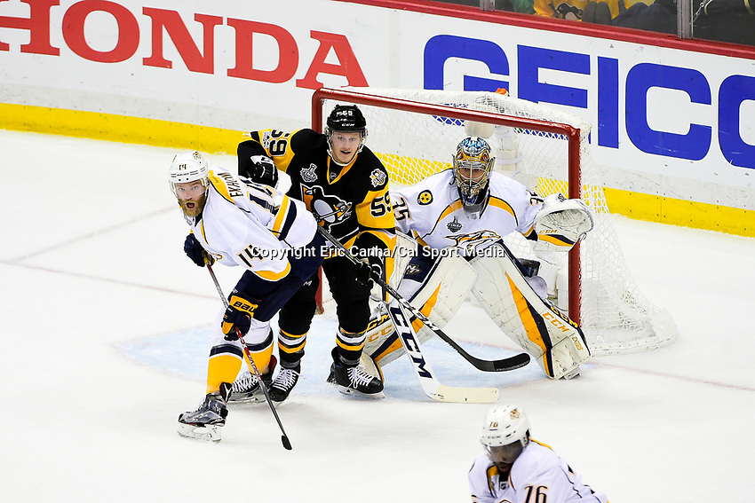 May 31, 2017: Nashville Predators defenseman Mattias Ekholm (14), Nashville Predators goalie Pekka Rinne (35), and Pittsburgh Penguins center Jake Guentzel (59) focus on the puck during game two of the National Hockey League Stanley Cup Finals between the Nashville Predators  and the Pittsburgh Penguins, held at PPG Paints Arena, in Pittsburgh, PA. The Penguins defeat the Predators 4-1 and lead the series 2-0. Eric Canha/CSM